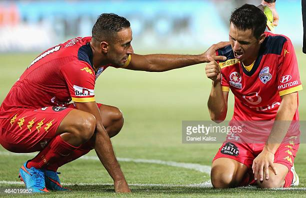Isaas Snchez of United reacts after being struck by Matthew Spiranovic of the Wanderers during the round 18 ALeague match between Adelaide United and...