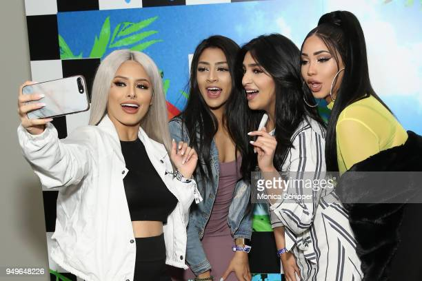 Isabel Bedoya and Melly Sanchez pose with fans during a Meet Greet during Beautycon Festival NYC 2018 Day 1 at Jacob Javits Center on April 21 2018...