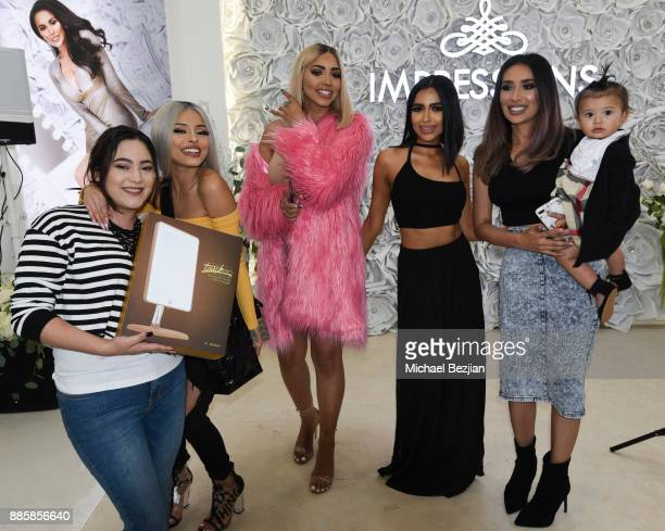 Isabel Bedoya Melly Sanchez Nida and Tamanna Roashan pose with fan at Impressions Vanity Melrose Grand Opening Gala on December 4 2017 in Los Angeles...