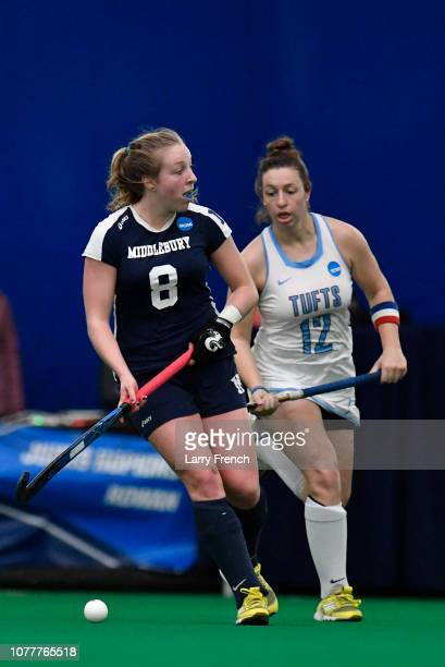 Isabel Chandler of the Middlebury Panthers guards the ball from Rachel Hamilton of the Tufts Jumbos during the Division III Women's Field Hockey...