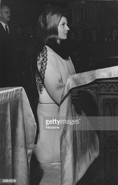 Isabel de Peron wife of the exiled former president of Argentina Juan Peron attending a mass at a church in Buenos Aires on the occasion of the 43rd...