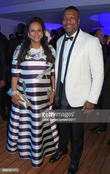 Isabel dos Santos and Chris Tucker attend the amfAR Gala Cannes 2017 at Hotel du CapEdenRoc on May 25 2017 in Cap d'Antibes France