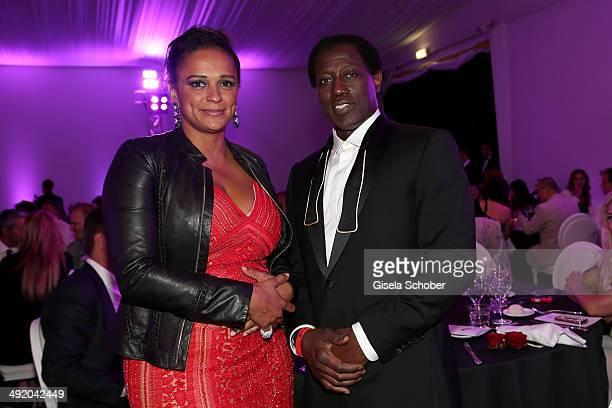 Isabel dos Santos and Wesley Snipes attend The Expendables 3 Official Cast Dinner Party at Gotha Club on May 18 2014 in Cannes France