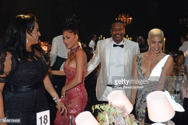 Isabel dos Santos Nicole Scherzinger Chris Tucker and Mette Towley attend the amfAR Gala Cannes 2018 dinner at Hotel du CapEdenRoc on May 17 2018 in...