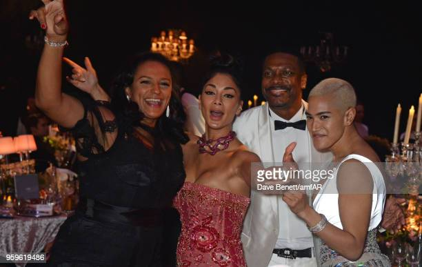 Isabel dos Santos, Nicole Scherzinger, Chris Tucker and Mette Towley attend the amfAR Gala Cannes 2018 dinner at Hotel du Cap-Eden-Roc on May 17,...