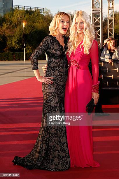 Isabel Edvardsson and Tina Kaiser attend the Deutscher Fernsehpreis 2013 Red Carpet Arrivals at Coloneum on October 02 2013 in Cologne Germany