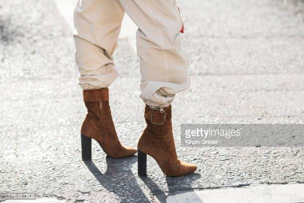 Isabel Froemming wears Saint Laurent boots and Stella McCartney trousers during LFW September 2020 at on September 18 2020 in London England
