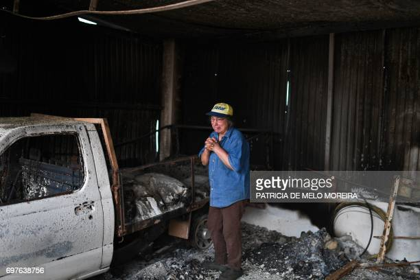 Isabel Godinho, 63 years old, cries inside her burnt garage affected by a wildfire at Vilas de Pedro, Figueiro dos Vinhos on June 19, 2017. More than...