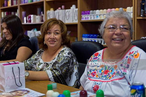 Isabel Hernandez unit leader and independent sales representative for Avon Products Inc center attends a weekly sales meeting in McAllen Texas US on...