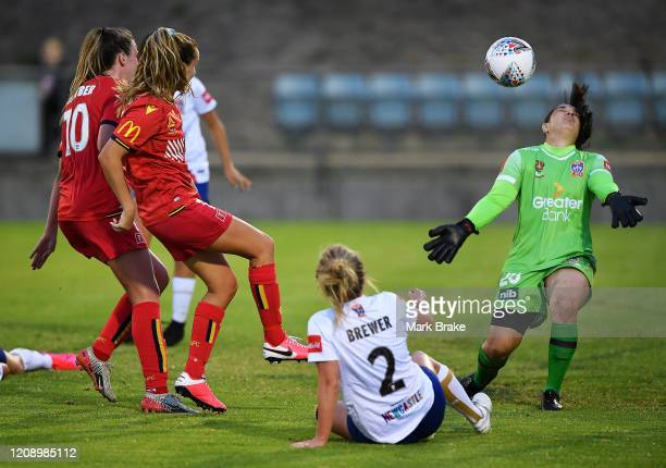 Isabel Hodgson of Adelaide United shoots for goal into the face of Claire Coelho goalkeeper of Newcastle Jets during the round 14 W-League match...