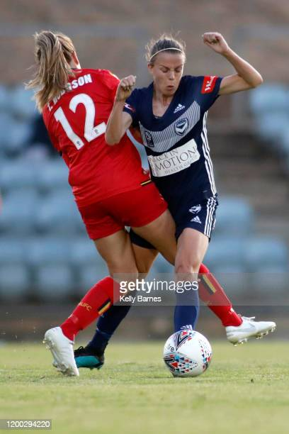 Isabel Hodgson of United tackles Amy Jackson of Victory during the round 10 W-League match between Adelaide United and the Melbourne Victory at...