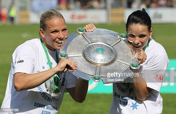 Isabel Kerschowski and AnnKatrin Berger of Potsdam celebrate their team's 80 win and their Deutsche Meister title following the women's First...