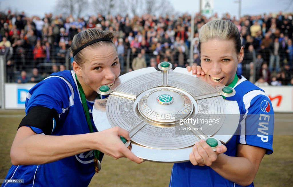 Isabel Kerschowski (L) and Monique Kerschowski (R) pose with the trophy after winning the Women Bundesliga match between Turbine Potsdam and Essen-Schoenebeck at the Karl-Liebknecht stadium on March 13, 2011 in Potsdam, Germany.
