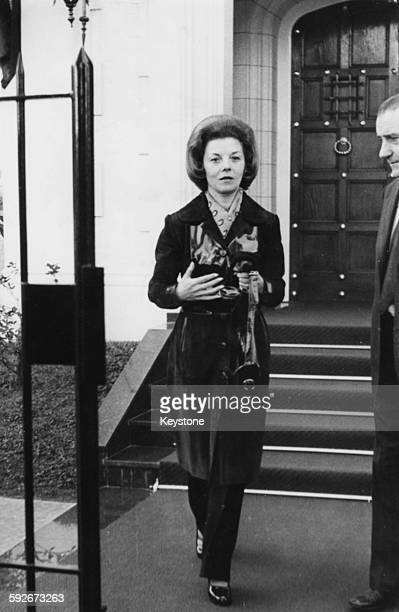 Isabel Martinez de Peron wife of President Juan Peron of Argentina pictured leaving the residence of Vicente Lopez during a visit to the Ministry of...