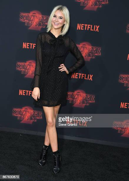 Isabel May arrives at the Premiere Of Netflix's Stranger Things Season 2 at Regency Bruin Theatre on October 26 2017 in Los Angeles California