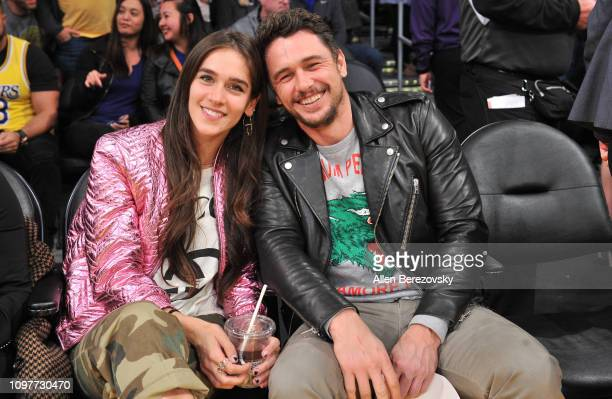 Isabel Pakzad and James Franco attend a basketball game between the Los Angeles Lakers and the Golden State Warriors at Staples Center on January 21...