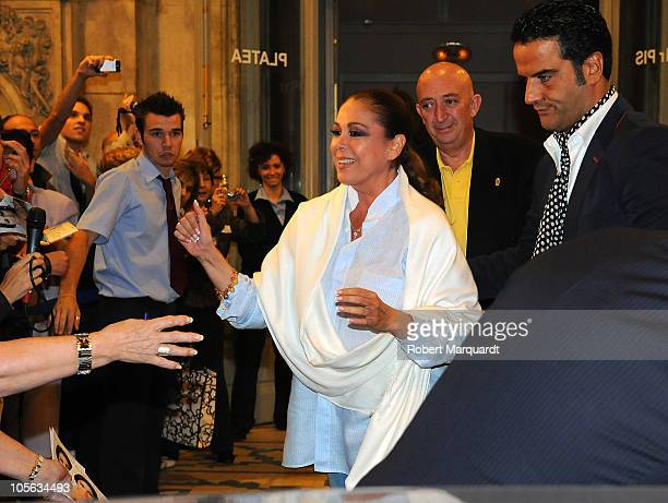 Isabel Pantoja greets her supporters after finishing a performance of her 'Asi es la vida' show at the Theater Coliseum on October 15, 2010 in...