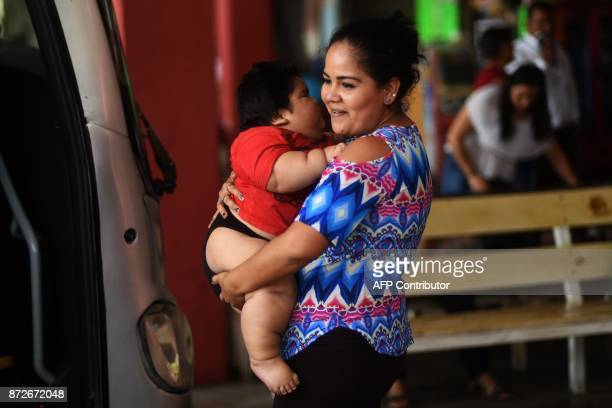 Isabel Pantoja holds her tenmonthold baby Luis Gonzales as they wait at the bus station in Colima city where they headed for Luis' medical chekup in...