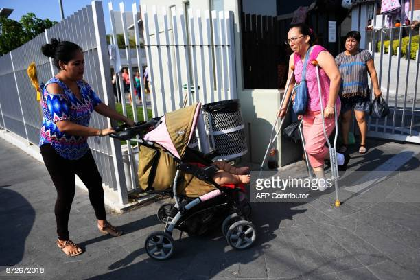 Isabel Pantoja pushes a stroller with her tenmonthold baby Luis Gonzales as they arrive at a clinic in Colima city for Luis' medical checkup in...