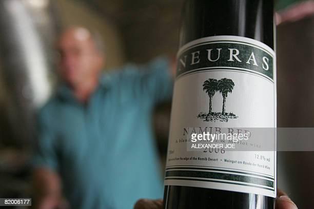 Isabel Parenthoen LifestyleNamibiawinedrinkdesert Allan WalkdenDavis tastes his wine in his vineyard in Neuras on the edge of the Namibian desert on...