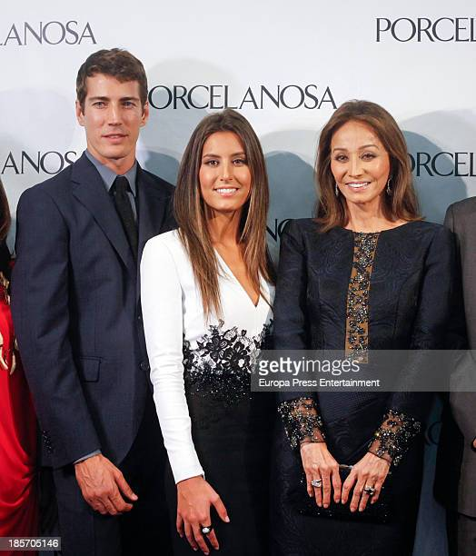 Isabel Preysler her daughter Ana Boyer and model Oriol Elcacho attend the opening of a Porcelanosa store on October 23 2013 in Cordoba Spain