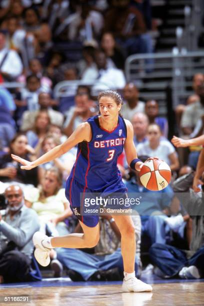 Isabel Sanchez of the Detroit moves the ball during the WNBA game against the Washington Mystic at The Palace of Auburn Hills on July 28 2004 in...