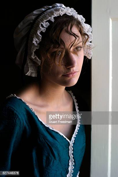 Isabel Snowden models period costume at the Jane Austen House Museum Chawton near Alton Hampshire UK Jane Austen was an English novelist whose...