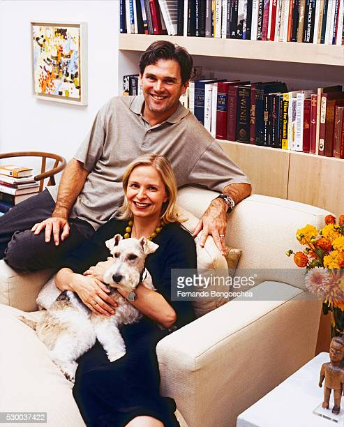 isabel von fluegge and skip d'amico sitting on chaise longue with dog - fernando bengoechea stock pictures, royalty-free photos & images