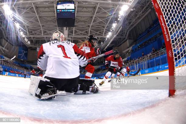 Isabel Waidacher of Switzerland competes for the puck against Shiori Koike and Nana Fujimoto of Japan in the third period during the Women's Ice...