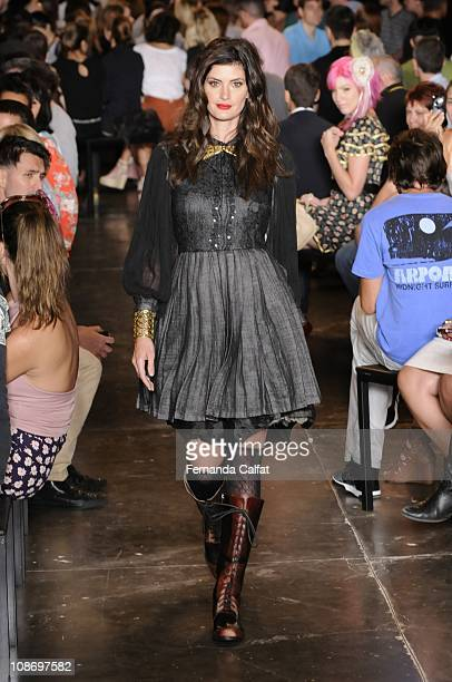 Isabela Fiorentino displays a design by Do Estilista during the fifth day of Sao Paulo Fashion Week Fall 2011 at Ibirapuera's Bienal Pavilion on...