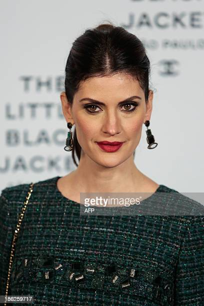 Isabela Fiorentino poses as she arrives for the opening ceremony of the Little Black Jacket exhibition of Chanel in Sao Paulo Brazil October 29 2013...