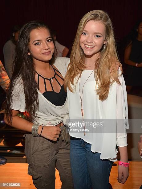 Isabela Moner and Jade Pettyjohn attend Breanna Yde's 13th Birthday Party at Lucky Strike Lanes at LA Live on June 11 2016 in Los Angeles California
