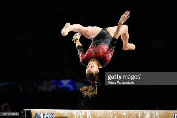 Isabela Onyshko of Canada competes on the balance beam during the qualification round of the Artistic Gymnastics World Championships on October 3...