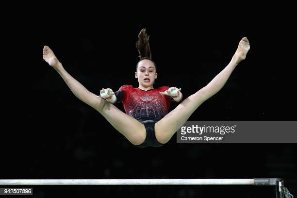 Isabela Onyshko of Canada competes on the uneven bars during the Women's Team Final and Individual Qualification Artistic Gymnastics on day two of...