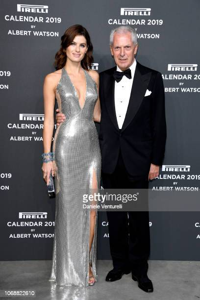Isabeli Fontana and Marco Tronchetti Provera walk the red carpet ahead of the 2019 Pirelli Calendar launch gala at HangarBicocca on December 5, 2018...