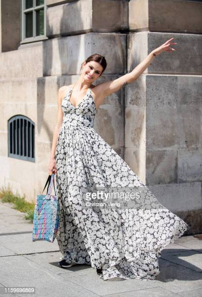 Isabeli Fontana is seen wearing dress outside Dundas during Paris Fashion Week - Haute Couture Fall/Winter 2019/2020 on July 01, 2019 in Paris,...