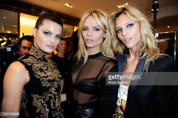 Isabeli Fontana Natasha Poly and Anja Rubik pose inside the Gucci store during the Vogue Fashion Celebration Night 2011 on Avenue Montaigne on...