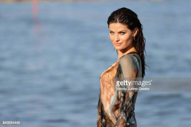 Isabeli Fontana poses for photographers ahead of the 74th Venice Film Festival on August 29 2017 in Venice Italy