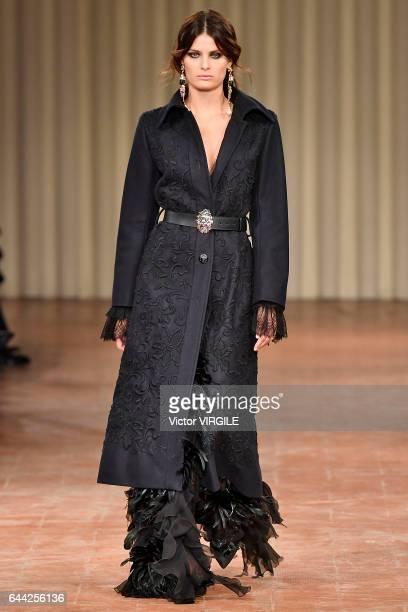 Isabeli Fontana walks the runway at the Alberta Ferretti Ready to Wear fashion show during Milan Fashion Week Fall/Winter 2017/18 on February 22 2017...