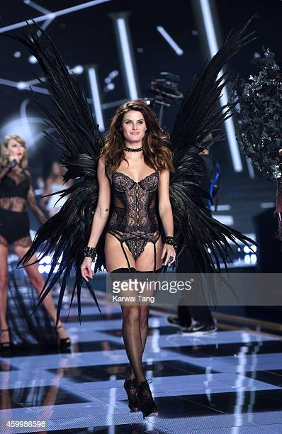 Isabeli Fontana walks the runway at the annual Victoria's Secret fashion show at Earls Court on December 2 2014 in London England