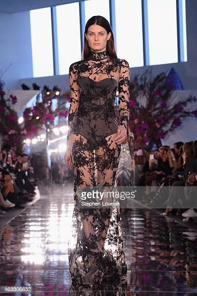 Isabeli Fontana walks the runway at the Gabriela Cadena fashion show during MercedesBenz Fashion Week Fall 2015 on February 12 2015 in New York City