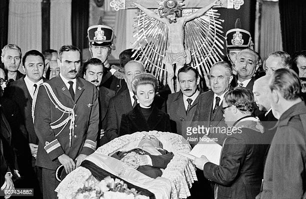 Isabelita Peron the new President of the Republic of Argentina near the body of her late husband former President Juan Peron