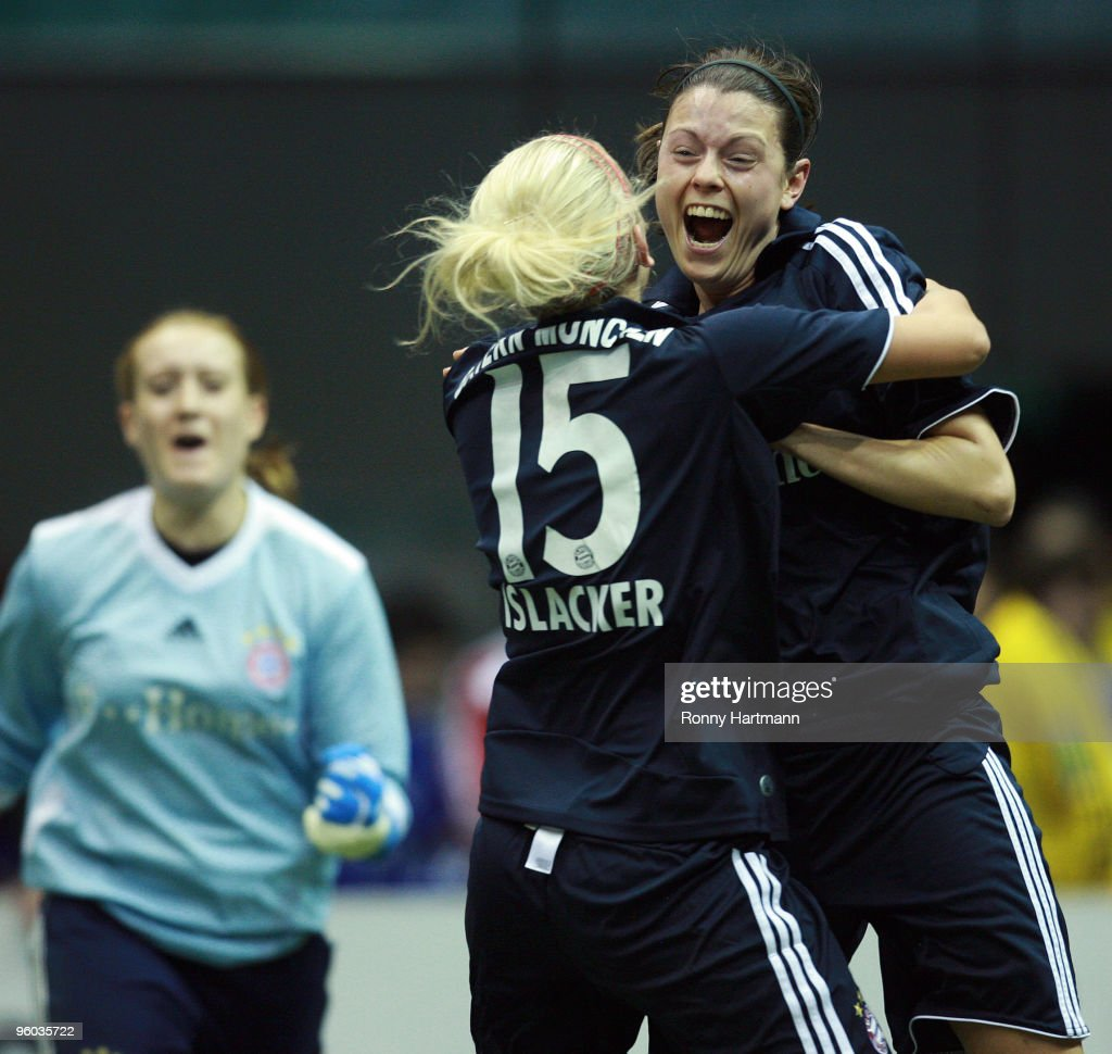 Isabell Bachor (R-L), Mandy Islacker and gaolkeeper Kathrin Laengert of FC Bayern Muenchen celebrate after winning the quarter final match against 1. FFC Frankfurt during the T-Home DFB Indoor Cup at the Boerdelandhalle on January 23, 2010 in Magdeburg, Germany.