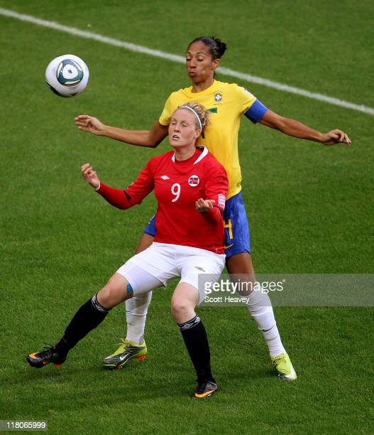 Isabell Herlovsen of Norway attempts to control the ball ahead of Aline of Brazil during the FIFA Women's World Cup 2011 Group D match between Brazil...