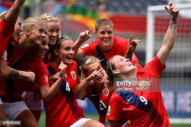 Isabell Herlovsen of Norway celebrates with team mates after scoring her teams third goal during the FIFA Women's World Cup 2015 Group B match...