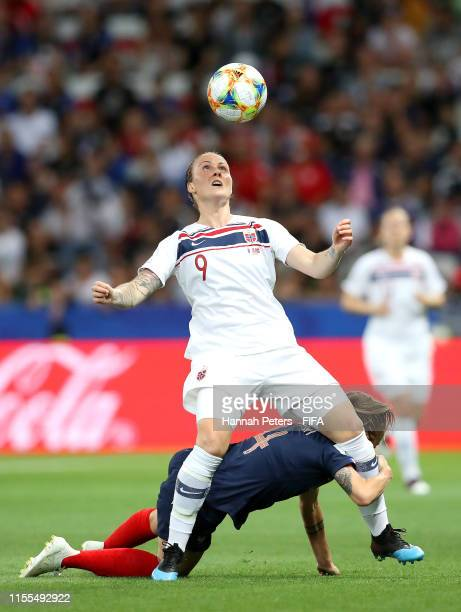 Isabell Herlovsen of Norway is challenged by Marion Torrent of France during the 2019 FIFA Women's World Cup France group A match between France and...