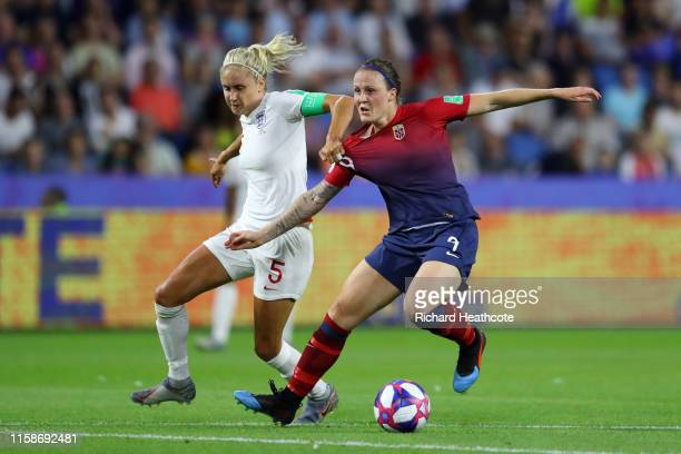 Isabell Herlovsen of Norway is challenged by Steph Houghton of England during the 2019 FIFA Women's World Cup France Quarter Final match between...