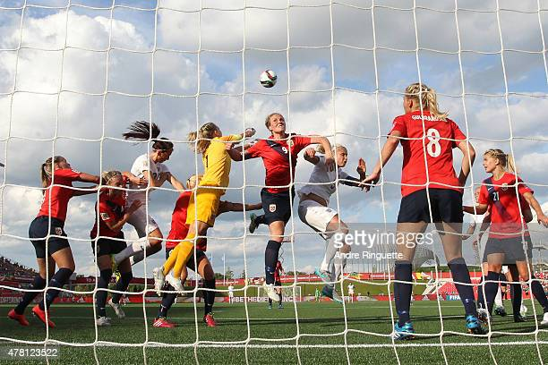 Isabell Herlovsen of Norway jumps up for a header to defend her net against England during the FIFA Women's World Cup Canada 2015 round of 16 match...