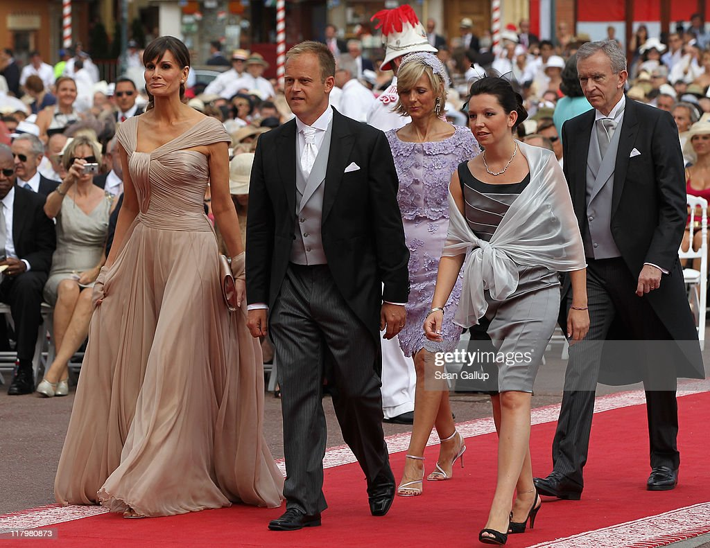 Isabell Kristensen (L), Helene Mercier Arnault (3rd L), Bernard Arnault (R) and guests attend the religious ceremony of the Royal Wedding of Prince Albert II of Monaco to Princess Charlene of Monaco in the main courtyard at the Prince's Palace on July 2, 2011 in Monaco. The Roman-Catholic ceremony follows the civil wedding which was held in the Throne Room of the Prince's Palace of Monaco on July 1. With her marriage to the head of state of the Principality of Monaco, Charlene Wittstock has become Princess consort of Monaco and gains the title, Princess Charlene of Monaco. Celebrations including concerts and firework displays are being held across several days, attended by a guest list of global celebrities and heads of state.