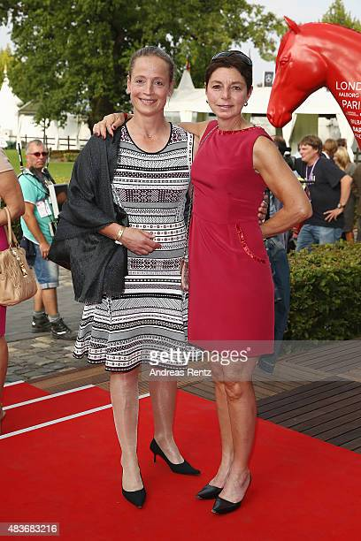 Isabell Werth and her sister attend the FEI European Championship 2015 media night on August 11 2015 in Aachen Germany